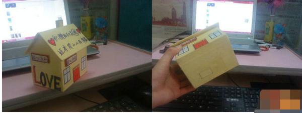 小房子  所需材料:纸皮、胶布、白纸、包装纸、胶水、彩色马克笔。 具体步骤: 1、把纸板箱拆开,从上面剪下所需纸板粘成以下左下图所示的房子外形的小盒子,注意两侧剪出三角形拱起的屋顶。 2、用剩余的硬纸板制作屋顶以及烟囱,用胶纸将屋顶与屋子粘为一体。  3、有白纸把硬纸板小房子内侧墙壁包好。 4、在屋顶上剪开一个用于投的长方形小开口。  5、初步制作完成的手工储蓄箱。  6、接下来就是要用包装纸给小房子的外表做装饰,贴上包装纸以后,还可以用马克笔在上面写下自己的座右铭或者画一些个性图案。  7、最后,用一张